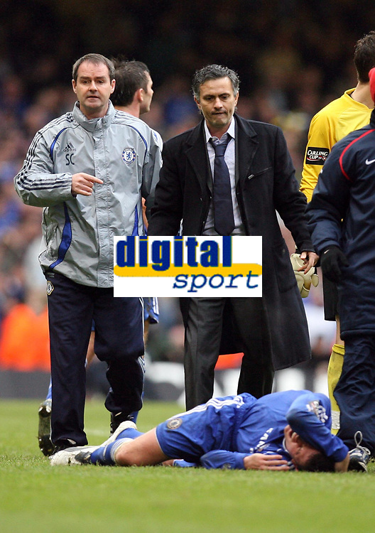 Photo: Rich Eaton.<br /> <br /> Chelsea v Arsenal. Carling Cup Final. 25/02/2007. Jose Mourinho, manager of Chelsea walks over to see Wayne Bridge of Chelsea who lies hurt on the floor after a second half brawl