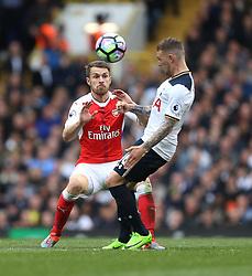 30 April 2017 London : Premier League Football : Tottenham Hotspur v Arsenal :<br /> Aaron Ramsey watches as Kieran Trippier of Tottenham heads the ball.<br /> Photo: Mark Leech