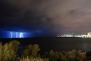 Israel, Tel Aviv, Lightning storm over the Mediterranean Sea. The Tel Aviv skyline on the right