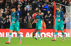 Tottenham Hotspur's Heung-Min Son (left), Kyle Walker-Peters, and Fernando Llorente (right) appears dejected after the final whistle