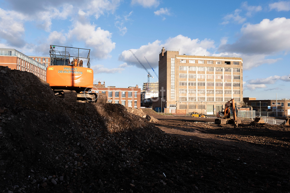 Diggers have stalled work on clearing a large site and moving a pile of bricks as part of a development / redevelopment of old industrial builindgs in the city centre on 26th November 2020 in Birmingham, United Kingdom. The city is under a long term and major redevelopment, with much of its industrial past being demolished and made into new flats for residential homes, as part of the Big City Plan.