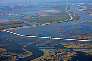 """Aerial view of The """"Great Wall"""" of Louisiana, built after Hurricane Katrina to protect New Olreans, with New Orleans cityscape in backround."""