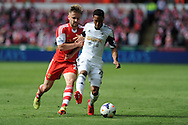 Southampton's Luke Shaw (l) holds onto Swansea's Jonathan de Guzman. Barclays Premier league match, Swansea city v Southampton at the Liberty stadium in Swansea, South Wales on Saturday 3rd May 2014.<br /> pic by Andrew Orchard, Andrew Orchard sports photography.