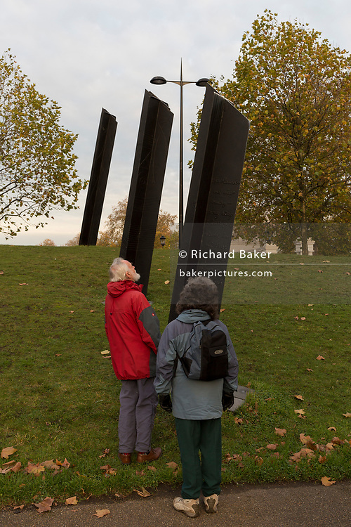 Visitors to the New Zealand war memorial at Hyde Park Corner, on 19th November 2017,in London, England.