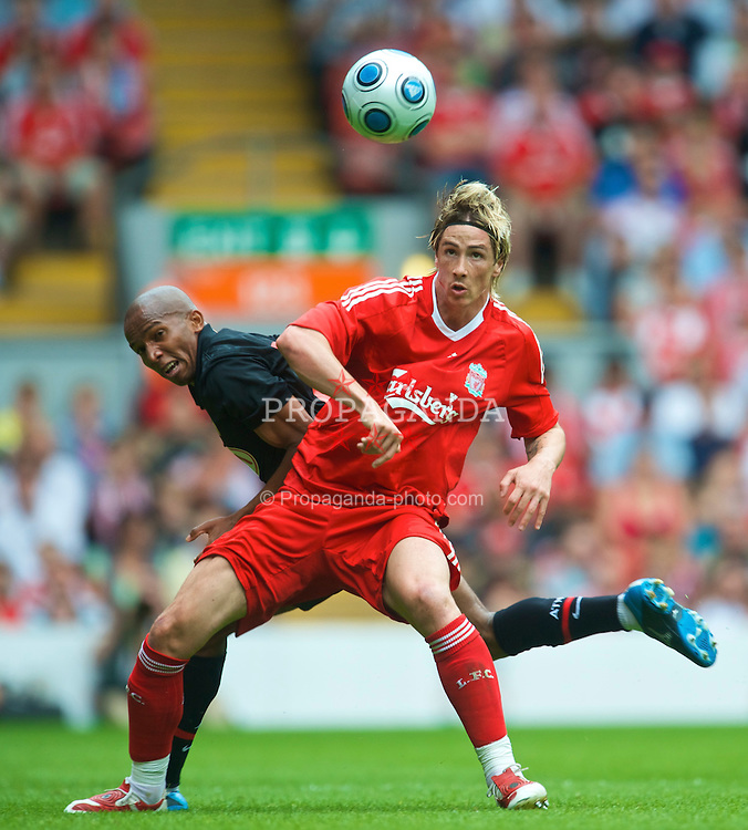 LIVERPOOL, ENGLAND - Saturday, August 8, 2009: Liverpool's Fernando Torres and Club Atletico de Madrid's Paulo Assuncao during the pre-season friendly match at Anfield. (Pic by: David Rawcliffe/Propaganda)