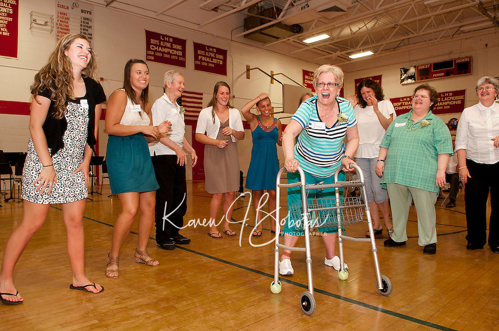 """Diane Maher joins in as the seniors play """"You've Got To Move It"""" at the Senior Senior Dance held Thursday evening at Laconia High School.  (Karen Bobotas/for the Laconia Daily Sun)"""