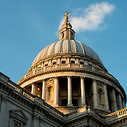 The setting sun catches the dome of St Paul's Cathedral, one of the most distinctive of London's landmarks. There has been a church on this site since 604 AD. The current building, with it's massive dome, was designed by Christopher Wren and dates back to the late 17th century.