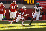 Ameer Abdullah dances through the shadows against Michigan State at Memorial Stadium on Nov. 16, 2013. © Aaron Babcock