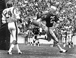 Raider Fred Biletnikorr scores TD against the Rams, #24 Clancy Williams..<br />(1971 photo/Ron Riesterer)