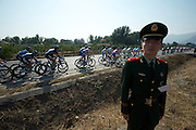 Military personal lined the entire length of the 137km stage. 2011 Tour of Beijing Stage 2