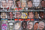 Detail of celebrity faces masks lined-up in a west end tourist shop rack