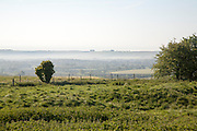 Early morning ground fog lying over fields in the Vale of Pewsey, near Alton Barnes, Wiltshire, England