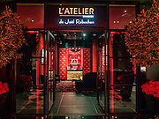 29 JANUARY 2016 - BANGKOK, THAILAND: The entrance to L'atelier de Joel Robuchon, an exclusive French restaurant owned by French chef Joel Robuchon. The restaurant features counter style seating which looks into the kitchen so diners can watch the chefs work.          PHOTO BY JACK KURTZ