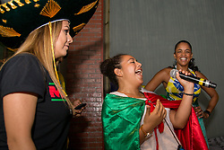 July 2, 2018 - FL, USA - Mexico fan Berenice Rivera, center, performs a mariachi chant during halftime at a FIFA World Cup Round of 16 knockout stage watch party featuring Brazil versus Mexico at Vares in Brickell on Monday, July 2, 2018. (Credit Image: © Sam Navarro/TNS via ZUMA Wire)