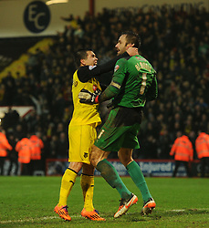 Watford's Manuel Almunia celebrates after saving a penalty with Watford's Cristian Battocchio - Photo mandatory by-line: Alex James/JMP - Tel: Mobile: 07966 386802 18/01/2014 - SPORT - FOOTBALL - Goldsands Stadium - Bournemouth - Bournemouth v Watford - Sky Bet Championship