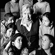 Sister Norma Pimentel has watched nearly 60,000 immigrants pass through the Humanitarian Respite Center at Sacred Heart Catholic Church in McAllen. The majority of people who pass through are women and children from Central America. (4X5 Ilford HP5) photo by Nathan Lambrecht