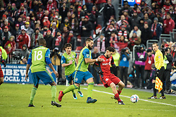 December 9, 2017 - Toronto, Ontario, Canada - Toronto FC midfielder JONATHAN OSORIO (21) fights for the ball against Seattle Sounders midfielder CLINT DEMPSEY (2) while Seattle Sounders defender KELVIN LEERDAM (18) looks on during the MLS Cup championship match at BMO Field in Toronto, Canada.  Toronto FC defeats Seattle Sounders 2 to 0. (Credit Image: © Mark Smith via ZUMA Wire)