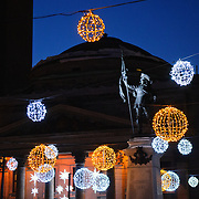 Illuminated lights decorate the Place d'Armes square in front of the the Basilique Notre-Dame de Montreal.