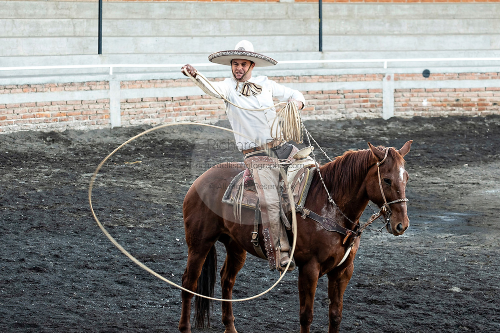 Luis Alfonso Franco shows off his roping skills on horseback during a family Charreria practice session in the Jalisco Highlands town of Capilla de Guadalupe, Mexico. The Franco family has dominated Mexican rodeo for 40-years and has won three national championships, five second places and five third places.