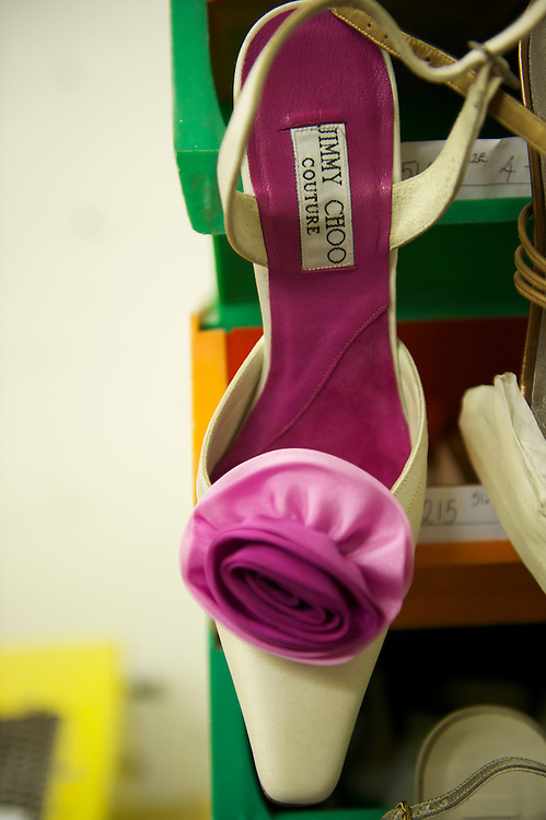 A pair of bespoke Jimmy Choo shoes hangs on display in his studio on Cannaught Street, London, March 22, 2010.