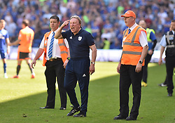 Cardiff City manager Neil Warnock (centre) gestures on the touchline during the Sky Bet Championship match at the Cardiff City Stadium.