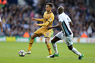 Dele Alli of Tottenham Hotspur goes past Allan Nyom of West Bromwich Albion . Premier league match, West Bromwich Albion v Tottenham Hotspur at the Hawthorns stadium in West Bromwich, Midlands on Saturday 15th October 2016. pic by Andrew Orchard, Andrew Orchard sports photography.