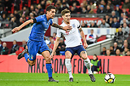 England Defender John Stones (5) and Italy Midfielder Lorenzo Pellegrini (16) battle for the ball during the Friendly match between England and Italy at Wembley Stadium, London, England on 27 March 2018. Picture by Stephen Wright.