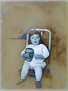 partly solarized portrait of a toddler holding a basket toy France ca 1920s