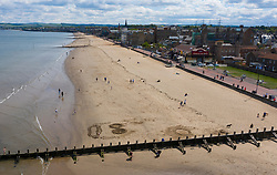 Portobello, Scotland, UK. 8 May 2020.  Aerial view of Portobello Beach on Friday lunchtime before holiday weekend. Sunshine and a temperature of 18C had authorities concerned that many people might ignore Covid-19 lockdown. However photo indicates beach is relatively quiet and only marginally busier than normal at this time of day. Iain Masterton/Alamy Live News
