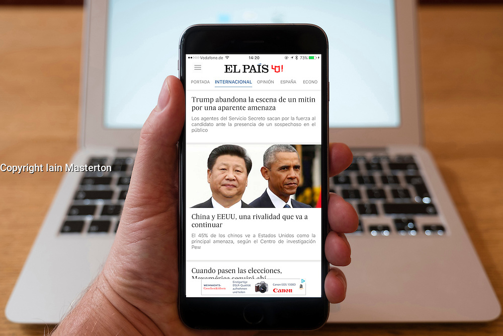 Using iPhone smartphone to display headlines on front page of El Pais Spanish newspaper