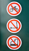 Prohibiting signs: No roller skates, No bicycles, No scooters