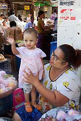 Vender With Child Near Gyee Zai Market