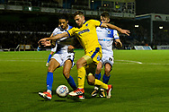 Ben Purrington (3) of AFC Wimbledon battles for possession with Daniel Leadbitter (2) of Bristol Rovers and Ollie Clarke (8) of Bristol Rovers during the EFL Sky Bet League 1 match between Bristol Rovers and AFC Wimbledon at the Memorial Stadium, Bristol, England on 23 October 2018.