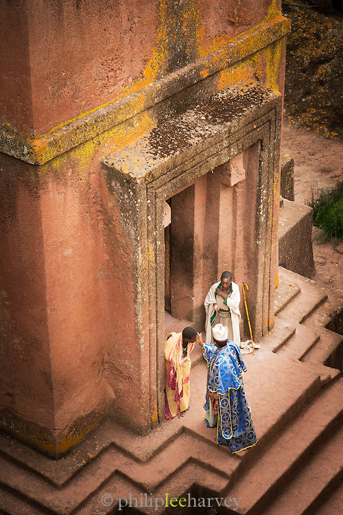 A priest greets worshippers at St George's Church, Lalibela, one of Ethiopia's holiest cities, second only to Aksum, and is a centre of pilgrimage for much of the country