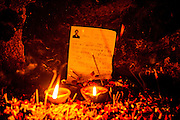 4th December 2014, New Delhi, India. Votive candles burn with photocopied requests left by believers to Djinns in the ruins of Feroz Shah Kotla in New Delhi, India on the 4th December 2014<br /> <br /> PHOTOGRAPH BY AND COPYRIGHT OF SIMON DE TREY-WHITE a photographer in delhi<br /> + 91 98103 99809. Email: simon@simondetreywhite.com<br /> <br /> People have been coming to Firoz Shah Kotla to leave written notes and offerings for Djinns in the hopes of getting wishes granted since the late 1970's, as many individual Djinns are thought to occupy the complex believers distribute photocopies throughout. <br /> Feroz Shah Tughlaq (r. 1351–88), the Sultan of Delhi, established the fortified city of Ferozabad in 1354, as the new capital of the Delhi Sultanate, and included in it the site of the present Feroz Shah Kotla. Kotla literally means fortress or citadel. The pillar, also called obelisk or Lat is an Ashoka Column, attributed to Mauryan ruler Ashoka. The 13.1 metres high column, made of polished sandstone and dating from the 3rd Century BC, was brought from Ambala in 14th century AD under orders of Feroz Shah. It was installed on a three-tiered arcaded pavilion near the congregational mosque, inside the Sultanate's fort. In centuries that followed, much of the structure and buildings near it were destroyed as subsequent rulers dismantled them and reused the spolia as building materials.
