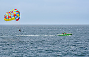 Parasailers Being Towed by a Speed Boat Just off the Balboa Pier