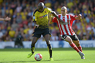 Allan-Romeo Nyom of Watford is challenged by Oriol Romeu of Southampton. Barclays Premier League, Watford v Southampton at Vicarage Road in London on Sunday 23rd August 2015.<br /> pic by John Patrick Fletcher, Andrew Orchard sports photography.