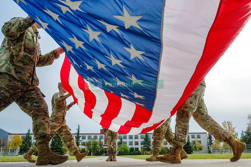 Soldiers assigned to the 95th Chemical Company, 17th Combat Sustainment Support Battalion, U.S. Army Alaska, fold the American flag while performing the daily flag retirement detail on Joint Base Elmendorf-Richardson, Alaska, Sept. 26, 2018. Retreat and To The Colors, the bugle calls accompanying flag retirement, signal the end to the official duty day on U.S. military installations. (U.S. Air Force photo by Justin Connaher)