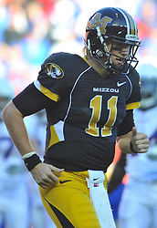 Nov 27, 2010; Kansas City, MO, USA; Missouri Tigers quarterback Blaine Gabbert (11) walks to the huddle in the second half of the game against the Kansas Jayhawks at Arrowhead Stadium. Missouri won 35-7. Mandatory Credit: Denny Medley-US PRESSWIRE