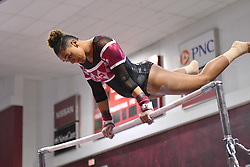 March 9, 2018 - Philadelphia, Pennsylvania, U.S - Temple Owls gymnast YASMIN EBUBANKS warms up on uneven bars during a meet held in Philadelphia, PA. Temple finished second to Maryland in the tri-meet. (Credit Image: © Ken Inness via ZUMA Wire)