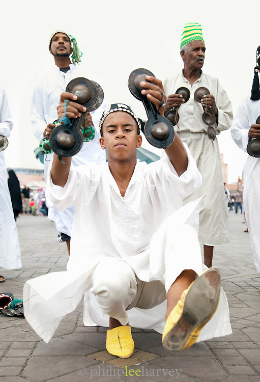 A band playing their instruments in the Djemaa el Fna in the medina of Marrakech, Morocco