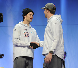 January 29, 2018 - Minneapolis, Minnesota, U.S - New England Patriots quarterback TOM BRADY, left, greets Philadelphia Eagles quarterback NICK FOLES at Super Bowl LII Opening Night at the Xcel Energy Center in St. Paul, Minnesota. (Credit Image: © Craig Lassig via ZUMA Wire)