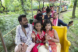 June 27, 2017 - Dhaka, Bangladesh - Bangladeshi children enjoy toy train ride at a park day after the Eid al-Fitr in Dhaka, Bangladesh, June 27, 2017. (Credit Image: © Suvra Kanti Das via ZUMA Wire)