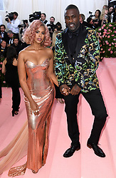 """Idris Elba and Sabrina Dhowre at the 2019 Costume Institute Benefit Gala celebrating the opening of """"Camp: Notes on Fashion"""".<br />(The Metropolitan Museum of Art, NYC)"""