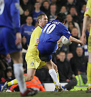 Photo: Lee Earle.<br /> Chelsea v Colchester United. The FA Cup. 19/02/2006. Chelsea's Joe Cole (C) scores their third.