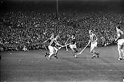 07/09/1969<br /> 09/07/1969<br /> 7 September 1969<br /> All-Ireland Senior Hurling Final: Kilkenny v Cork at Croke Park, Dublin.  <br /> Kilkenny full-back, Sean Treacy, with the ball and Kilkenny back, P. MacAindre, tries to get past Cork full-forward, C. MacCarthaigh (center of the picture), and Cork, full-forward, T.O. Riain.