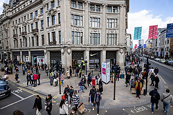 © Licensed to London News Pictures. 12/04/2021. London, UK. Busy streets at Oxford Circus as shoppers return to central London. Pubs, restaurants and non-essential shops reopened on Monday 12 April 2021 as England begins the second phase of 'unlocking' after months of lockdown. Photo credit: Rob Pinney/LNP