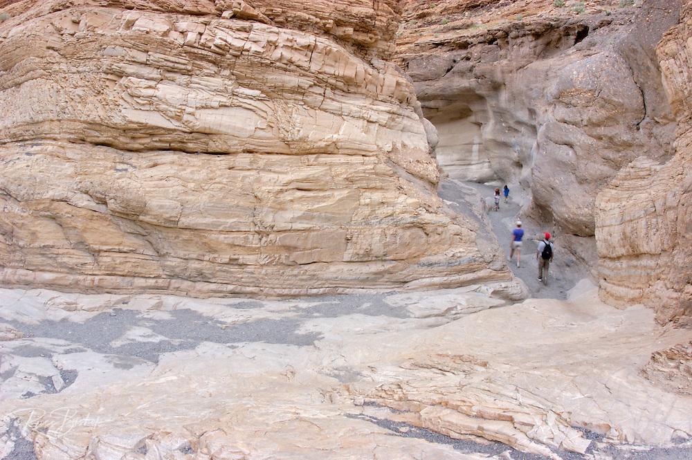 Family hiking through Mosaic Canyon, Death Valley National Park, California