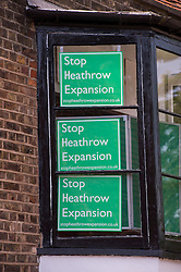 "© London News pictures...  01/07/2015. Harmondsworth, UK. ""Stop Heathrow Expansion"" signs in the window of a building in Harmondsworth in West London. Harmondsworth is due to be demolished to make way for a third runway at Heathrow Airport if plans go ahead. The airports commission today (Weds) gave it's backing for the £18.6bn plan for a third runway at Heathrow. Photo credit: Ben Cawthra/LNP"