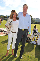 CAROLE LANGTON holding Puff the dog and the MARQUESS OF WORCESTER at a cricket match to in aid of CARE - Corfu Animal Rescue Establishment held at Hawkley Cricket Club, Hawkley, Hampshire on 8th September 2012.